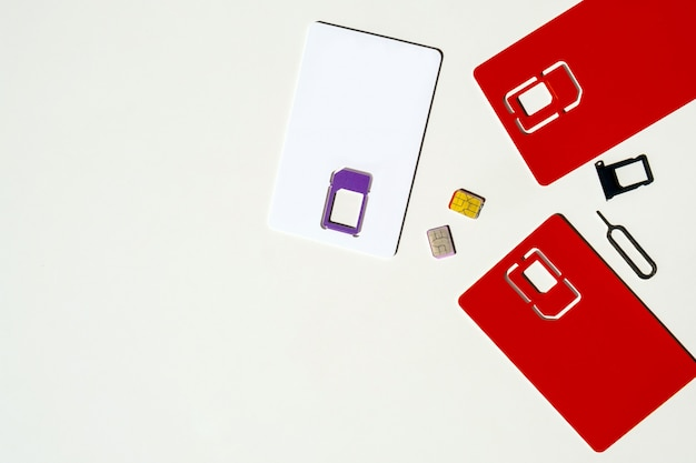Sim card slot white background red gsm phone copy space