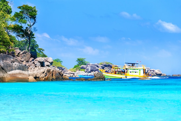 Similan islands, thailand. ship with tourists near the island. tropical landscape.