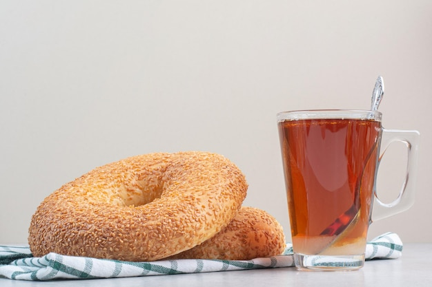 Simit with sesame seeds and glass of tea. high quality photo