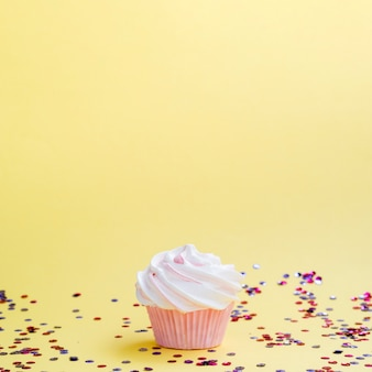 Simple birthday muffin and confetti