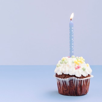 Simple birthday muffin with candle