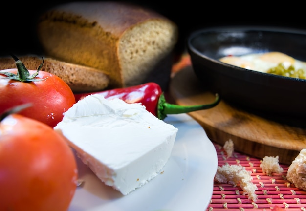 A simple breakfast with feta cheese in the foreground
