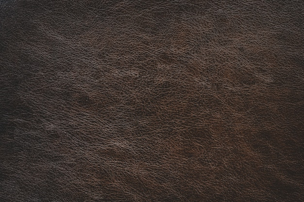 Simple brown leather texture background with gradient light used as luxury classic backdrop