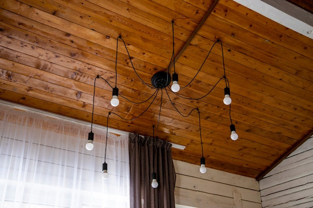 Simple chandelier spider in a wooden house. high quality photo