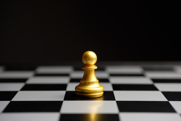 Simple chess piece pawn on a board