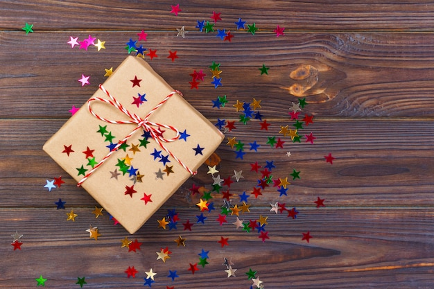 Simple christmas gift with red twine and decor stars