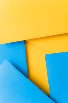 シンプルな幾何学的な黄色と青のカードの背景