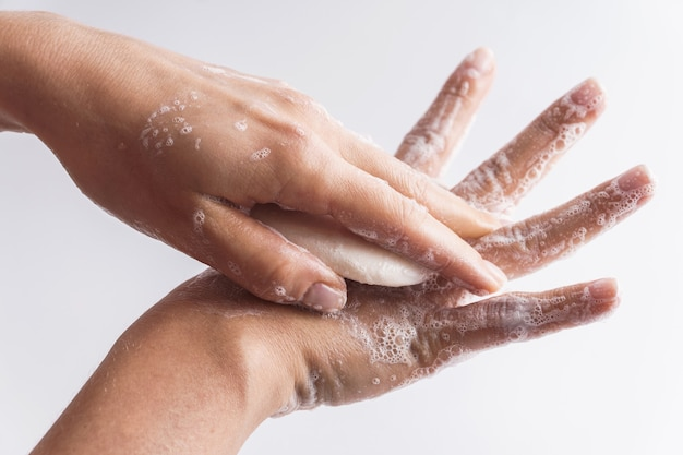 Simple hygiene routine. woman is washing her hands. close-up of female hands with a soap.