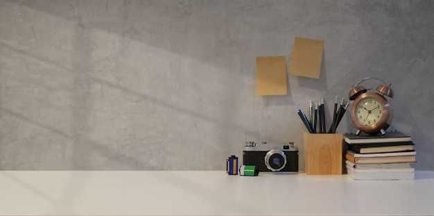 Simple photographer workplace with vintage camera