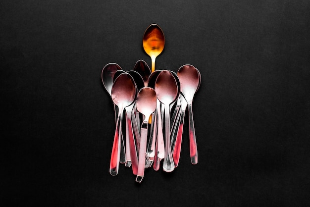 Simple style stainless steel cutlery viewed from above isolated on black.
