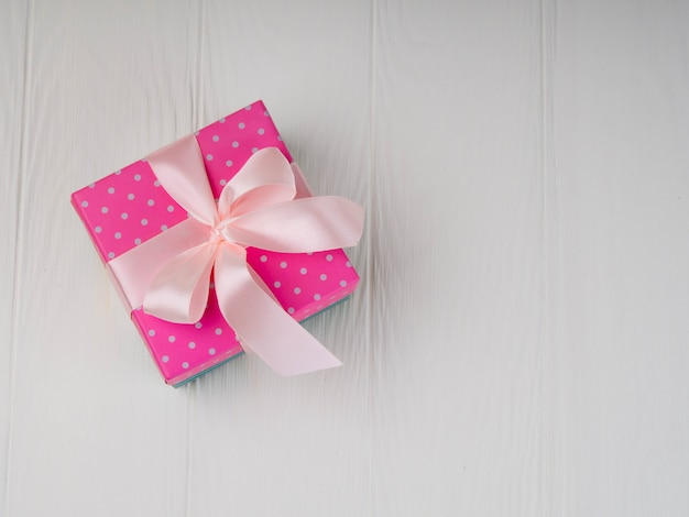 A simple white background with pink box, minimalism.