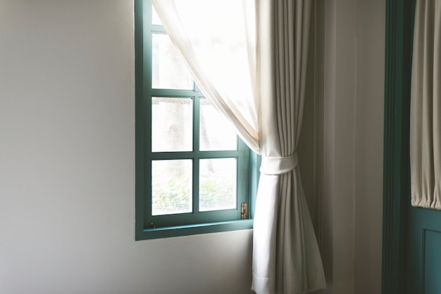 Simple window with white curtain