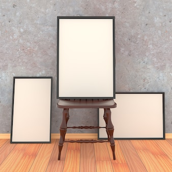 Simple wooden chair with three blank canvas in a black frame on the background