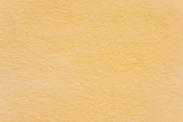 Simple yellow wall background texture