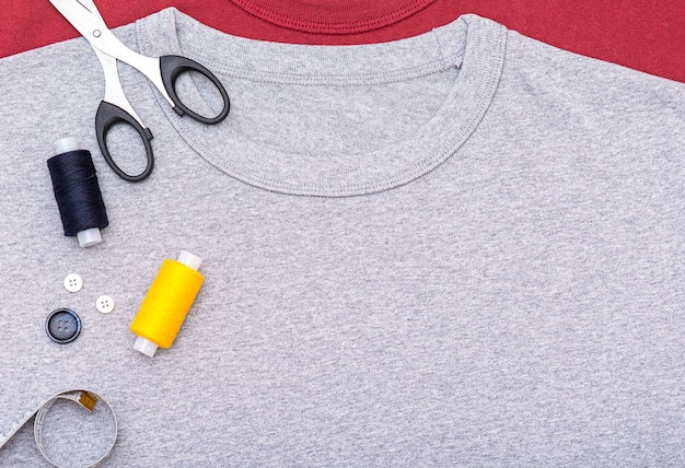 Simply composition with buttons, tape measure, scissors, spool of thread