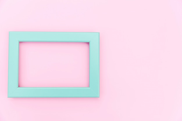 Simply design with empty blue frame isolated on pink pastel colorful background. top view, flat lay, copy space, mock up. minimal concept.
