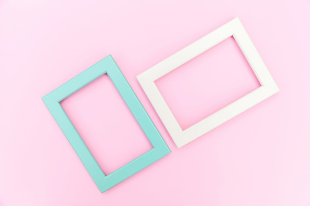 Simply design with empty pink and blue frame isolated on pink background