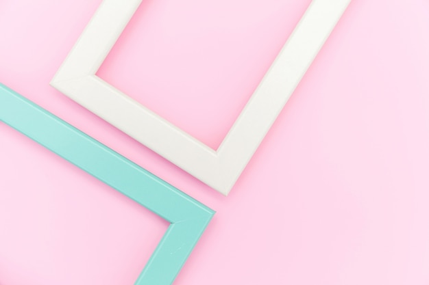 Simply design with empty pink and blue frame isolated on pink pastel colorful background