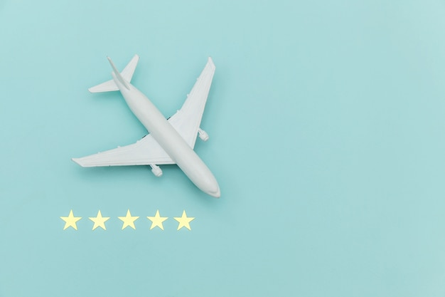 Simply flat lay design miniature toy model plane and 5 stars rating