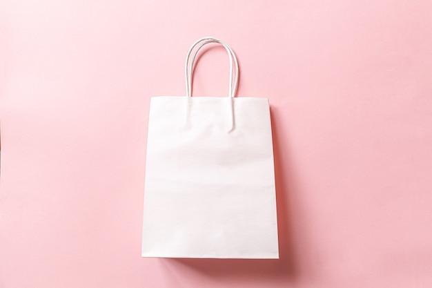 Simply minimal design shopping bag isolated on pink pastel background