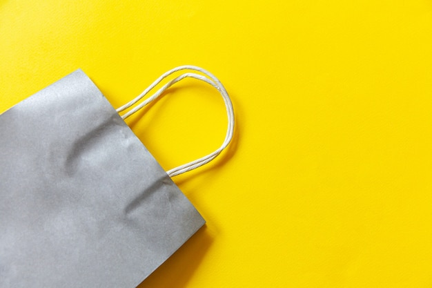 Simply minimal design shopping bag isolated on yellow background