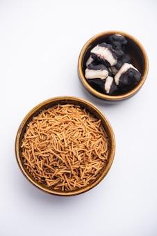 Singada or singhara garlic sev, namkeen shev a vrat food made using water chestnut served in a bowl