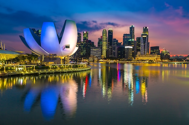 Singapore city skyline at night on a dawn sky