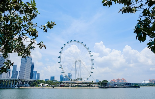 Singapore flyer, ferris wheel in sunny day, tourist attraction