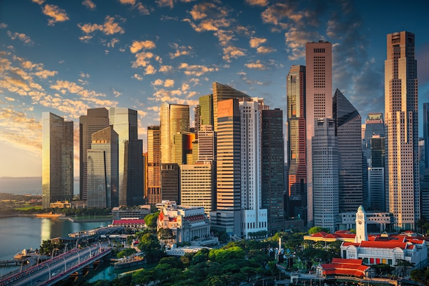 Singapore skyline with dramatic sky at sunrise.