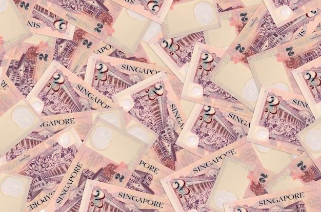 Singaporean dollars bills laying in big pile