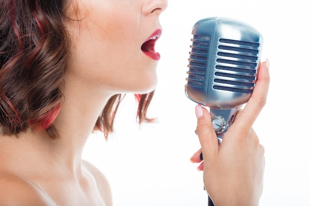 Singer woman with old microphone