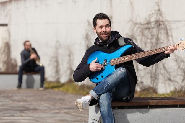 Singing guitarist outdoors