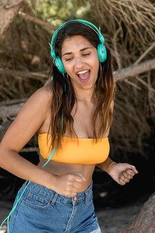Singing woman in headset listening music