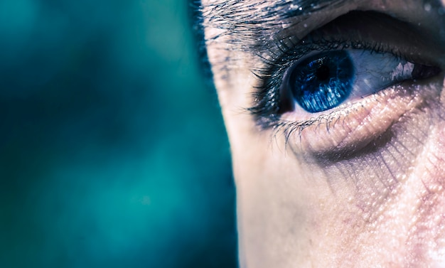 A single blue eye as a cyclope on blue background