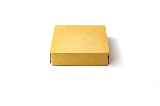 Single brown color flat kraft paper cardboard box isolate on white . close up view. selective soft focus. text copy space. packing, transportation, moving concept Premium Photo