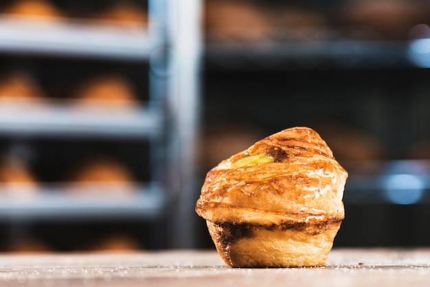 Single fresh baked sweet puff pastry on table