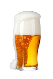 Single glass of beer close up isolated on white