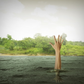 Single hand of drowning man