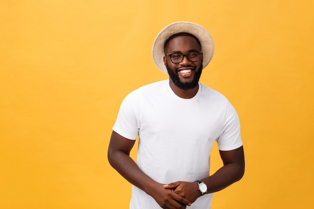 Single handsome muscular black man with hat and cheerful expression.