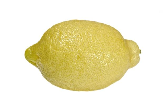 Single lemon on white surface