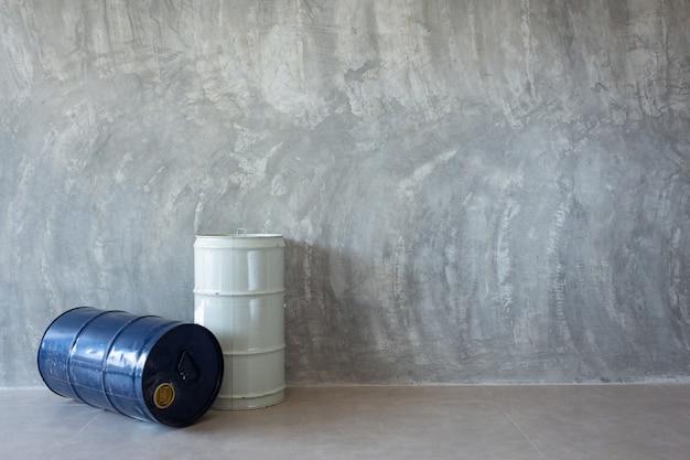 Single oil barrel on bare cement wall