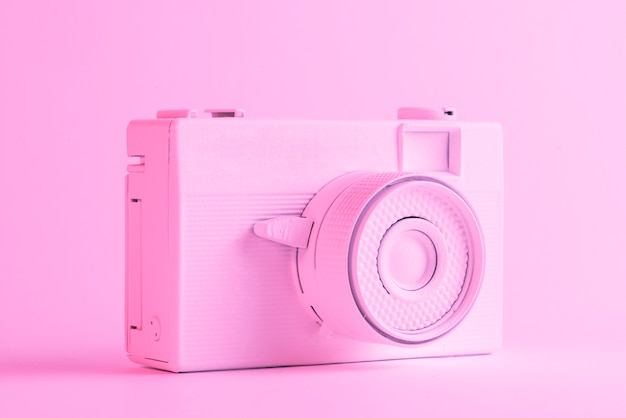 Single painted camera against colored pink backdrop