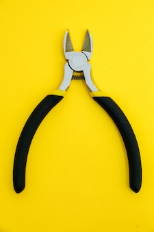 Single pliers tool with black rubber handles