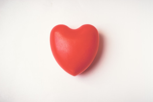 Single red ball foam with heart shape. happy st. valentines day. 14th february.