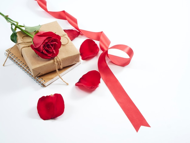 Single red rose and gift box. valentine's day concept