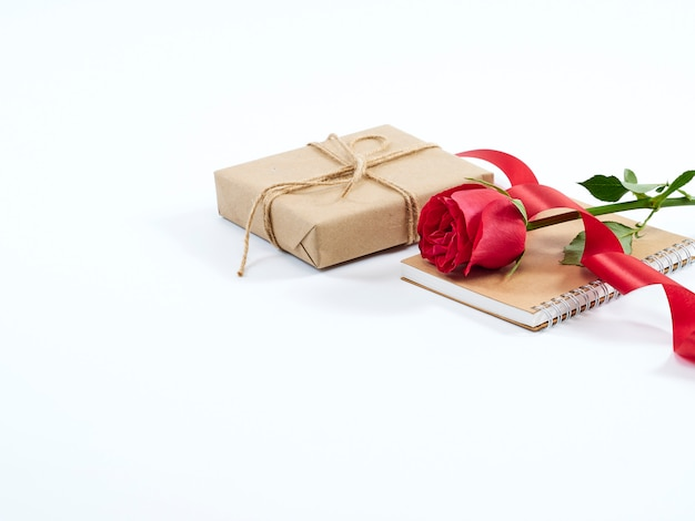 Single red rose and gift box.valentines day concept