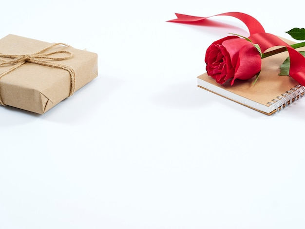Single red rose and gift box. valentines day concept