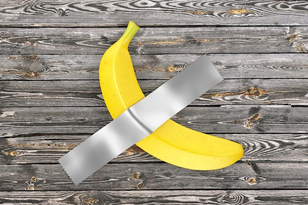 Single ripe yellow banana duct taped to wooden rustic plank wall extreme closeup. 3d rendering