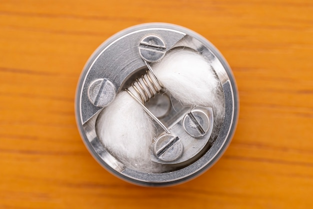 Single space coil with japanese organic cotton in high end rebuildable dripping atomizer