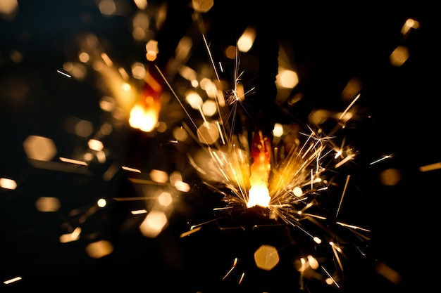 A single sparkler letting off a shower of gold flares and sparks